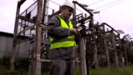 Electrician take pictures in electrical substation video