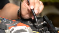 Electrician using voltmeter for checking video