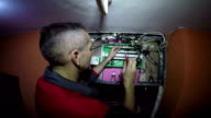 Electrician Working on the Automatic Circuit Breakers With Screwdriver video