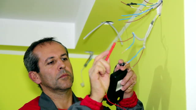 Electrician Working With Measuring Instrument and Wires video