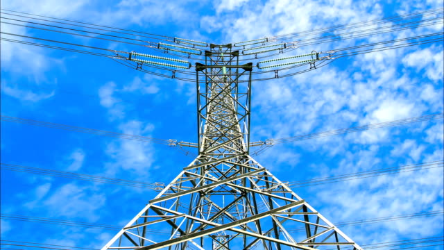 electricity high voltage power pylon against blue sky video