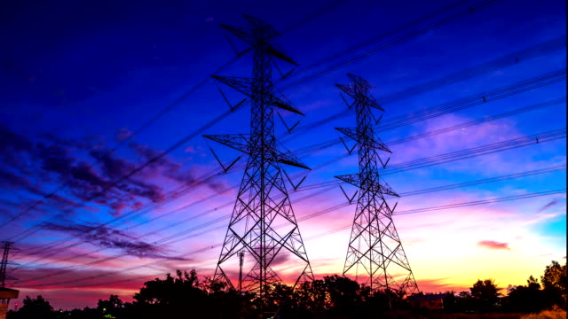 electricity high voltage power pylon at dusk video