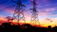 electricity high voltage power pylon at dusk video