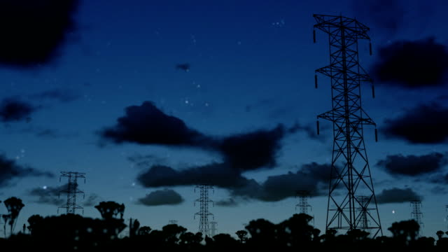 Electricity pillars at night, timelapse clouds video