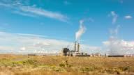 Electricity power station plant - wide shot, desert landscape, day video