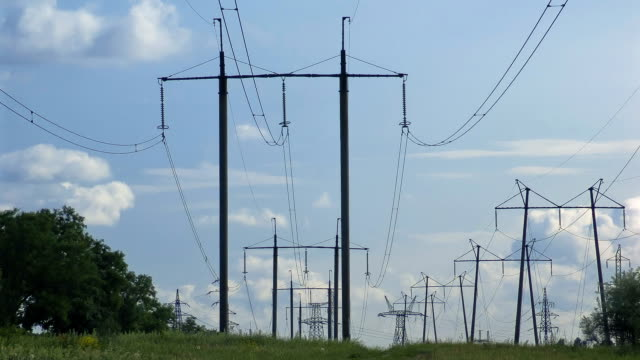 Electricity pylons with clouds overhead video
