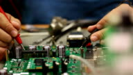 Electronic Engineer checking circuit board video