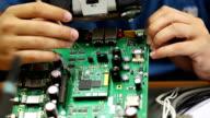 Electronic engineer repairs circuit board video