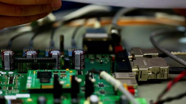 Electronic engineer testing circuit board video