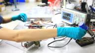 Electronic Engineer testing circuit board. video