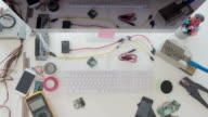 Electronics engineer measuring components on circuit board video