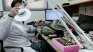 Electronics laboratory, checking circuit board video