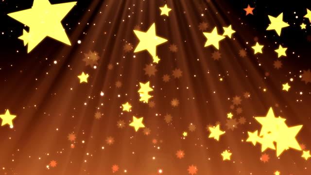Elegant Christmas, falling stars and snowflakes in festive beams video