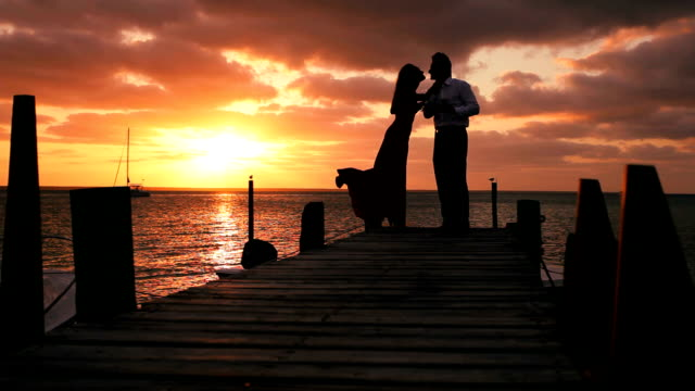Elegant Couple at Sunset with a Glass of Wine video