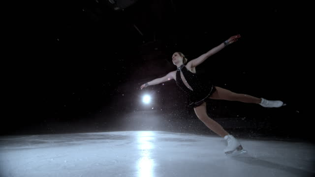 SLO MO DS Elegant female figure skater performing a jump video