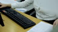 Elegant female hands types on a black computer keyboard video