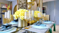 elegant glass and crockery on table in modern dining room video