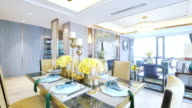 elegant glasses and crockery on table in modern dining room video