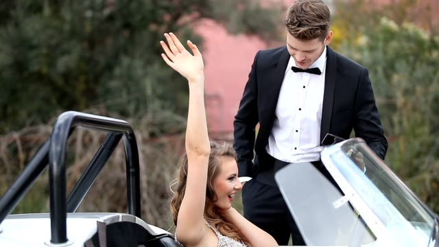 Elegant man and woman in vintage car video