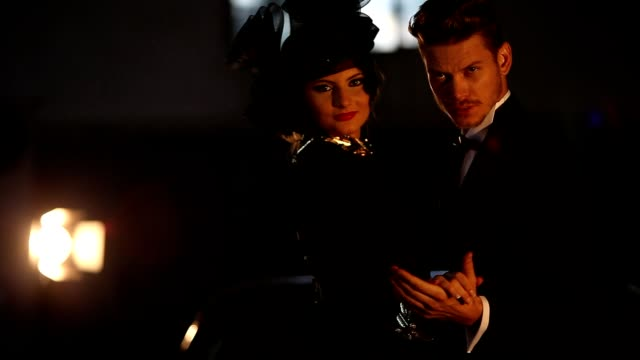 Elegant man and woman  wit black dress video