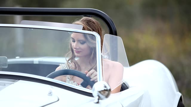 Elegant woman in vintage car video