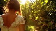 Elegant Young Female Model Vintage Dress Wlaking Forest HD video