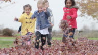 Elementary Children Play in Leaves on Schoolyard video