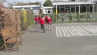 Elementary School Pupils Running Into Playground video