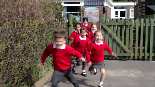 Elementary School Pupils Running Into Playground video