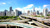 elevated road with crowded traffic and modern buildings in midtown of shanghai video
