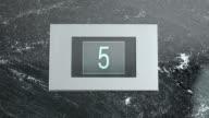 LD Elevator indicator showing floor numbers going down video
