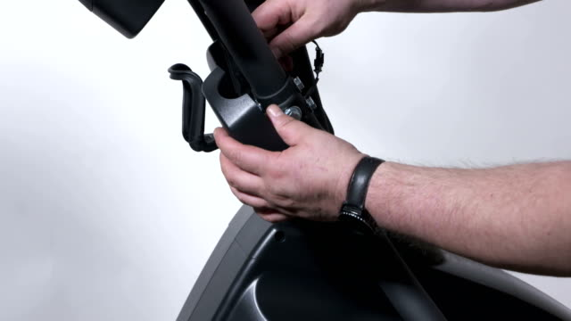 Elliptical trainer assembly process at home. video