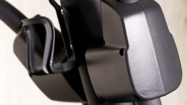 Elliptical trainer details in motion during workout closeup video