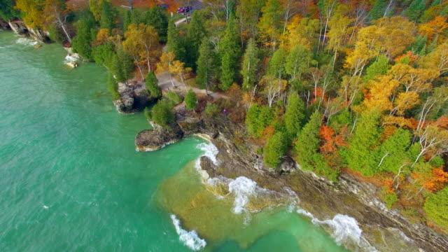 Emerald waves crash on rocky Autumn shores video