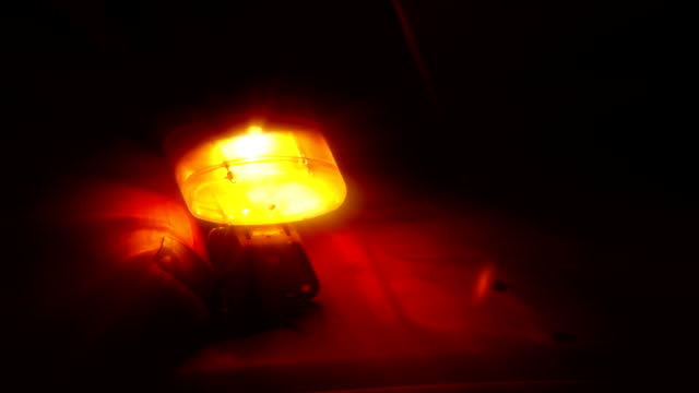 Emergency light or Flashing beacon. Orange flashing and revolving light on top of a support and services vehicle. video