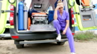 Emergency medical service upset tired paramedic sitting in front of ambulance video