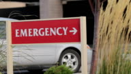 Emergency Room Sign - Car Pulls In video