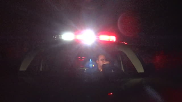 emergency vehicle responding to call hood mounted camera man talking on radio video