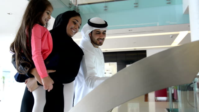 Emirati family using information display video