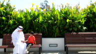 Emirati grandfather and grandson at the park video