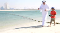 Emirati grandfather and little boy going fishing video