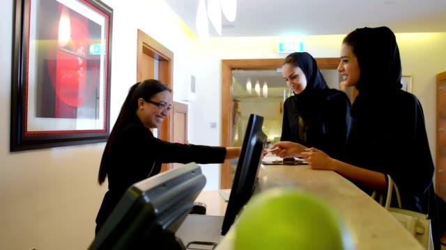 Emirati women paying via credit card video