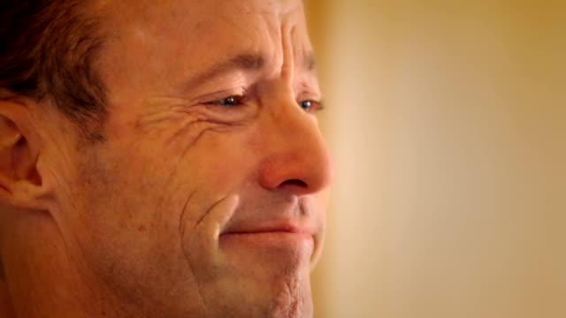 Emotional man cries tears of joy video