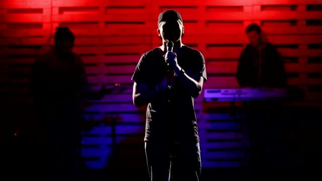 Emotional singer singing on illuminated stage video