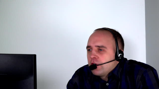 Emotional stressed consultant man in call center. video