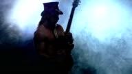 emotional strip man playing bass guitar, slow motion, smoke video