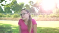 Emotional teenager girl looking at camera and smiling video