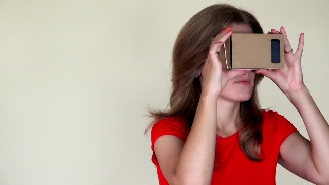 Emotional woman get scared of view from virtual reality glasses. closeup video