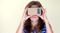 Emotional woman using virtual glasses. video