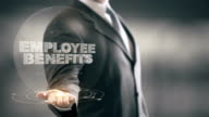 Employee Benefits Businessman Holding in Hand New technologies video